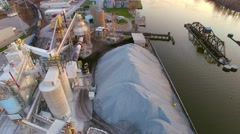 Daybreak aerial flyover of scenic industrial riverfront area - stock footage
