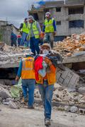 Quito, Ecuador - April,17, 2016: House destroyed by Earthquake with rescuers and - stock photo