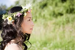 Woman wearing a flower headdress - stock photo
