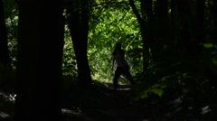 Silhouette girls dancing in the dark green Woods Stock Footage