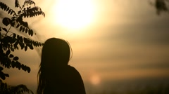 Silhouette of a dancing girl at sunset - stock footage