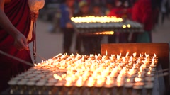 Nepal 1 Year After the Earthquake. Buddhists Lighting Candles 4K - stock footage