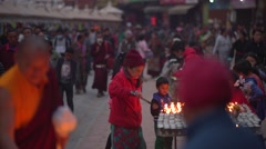 Nepal 1 Year After the Earthquake. Lighting Candles at Bodhnath 4K Stock Footage