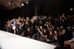 Blurred image of group audience at fashion show stage Stock Photos