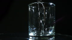 Pouring Water In The Glass Stock Footage
