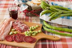 Cold meats broad bean and red wine - stock photo