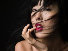 Woman licking her finger Stock Photos