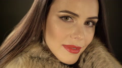 Attractive young woman posing in elegant fur jacket Stock Footage