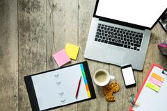 Laptop with other modern electonic devices on desk Stock Photos
