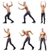 Ripped man pushing away virtual obstacle - stock photo