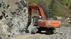 Excavator with a hydraulic hammer Stock Footage
