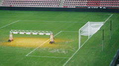 Light system for growing lawns at an empty football field. Stock Footage