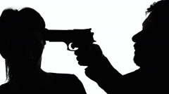 Silhouettes handgun man robbing woman Stock Footage