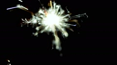 Sparkler shot against deep dark background. 50 FPS Slow Motion Stock Footage