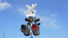 Railroad crossing with flashing red lights warning and announcing coming train - stock footage