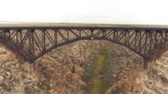 AERIAL: Empty steel arch railroad bridge across the Canyon Diablo Stock Footage
