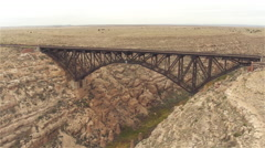 AERIAL: Empty steel arch railroad bridge across the Canyon Diablo - stock footage