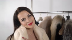 Elegant young woman in mink fur coat looking at the camera smiling Stock Footage