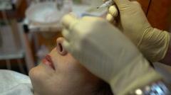Hands of beautician doing permanent makeup eyebrow - stock footage