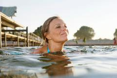 Woman swimming Stock Photos