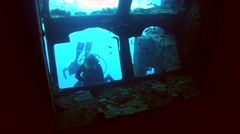 Diver looks inside the wreck Giannis D Stock Footage