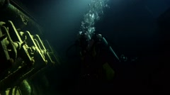 Diver inspects the engine room of the wreck Giannis D - stock footage