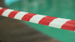 Red White Ribbon by the pool - stock footage