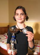 Girl holding a trophy and a medal - stock photo