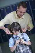 School girl being awarded medal - stock photo