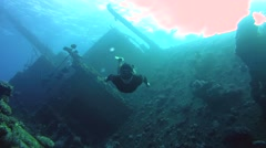 Freediver dives on the wreck Giannis D Stock Footage