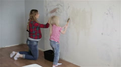 A mother and a daughter applying adhesive - stock footage