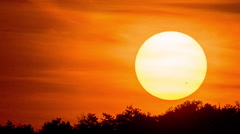 Sunset time lapse macro tele zoom powerful lens close up sun disk - stock footage