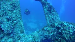 Diver looking at the wreck screw Dunraven - stock footage