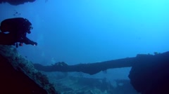 Diver swims inside the wreck Dunraven, Red Sea Stock Footage