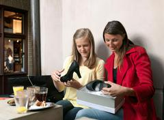 Mother and daughter shopping - stock photo