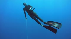 Freediver rises from the depths - stock footage