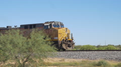 CLOSE UP: Locomotive moving long freight container train along railroad tracks Stock Footage