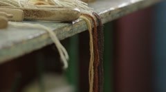 Weaving Threads On The Table 02 Stock Footage