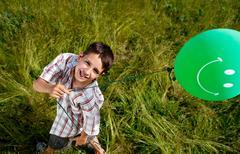 Boy holding balloon, elevated - stock photo