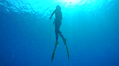 Freediver rises from the depths Stock Footage