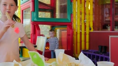 Kids eating and playing at a fast food restaurant. Stock Footage