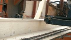 Wood cutting machine board log in a sawmill Stock Footage