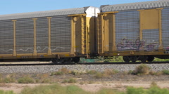 CLOSE UP: Long freight container train moving and transporting cargo Stock Footage