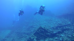 Divers inspect the wreckage of wreck ship SS Carnatic - stock footage