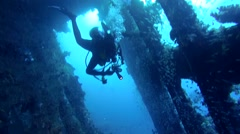 A diver swims inside wrecked ship SS Carnatic Stock Footage