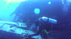 diver swimming over the wreckage of the wreck SS Thistlegorm - stock footage