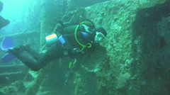 Diver swimming over the wreckage of the wreck SS Thistlegorm Stock Footage
