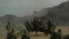 Howitzer Artillery Live Shoot - Wide shot of firing Stock Footage