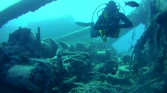 "diver inspects the winch mechanism on shipwreck ""SS Thistlegorm"". Red sea, - stock footage"