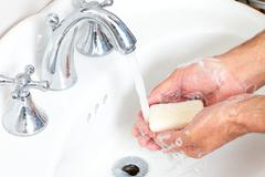 Man washing hands with soap and water. - stock photo
